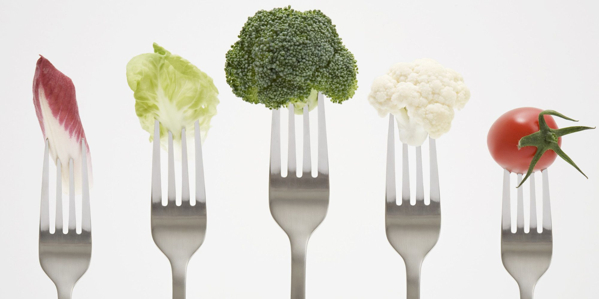 Close up of vegetables on forks